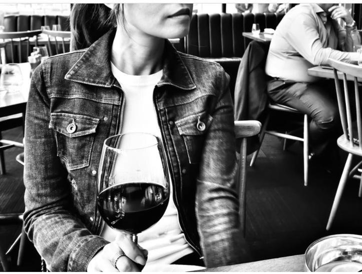 girl wine glass in restaurant writer